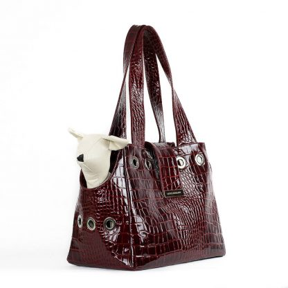 dog bag in burgundy patent leather with dog