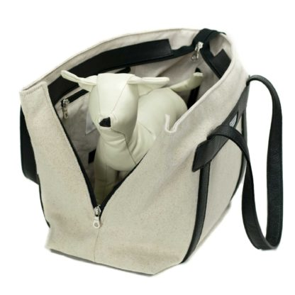 canvas dog carrier with leather black and dog inside