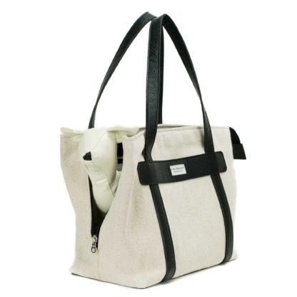 dog carrier in canvas and black leather with dog inside